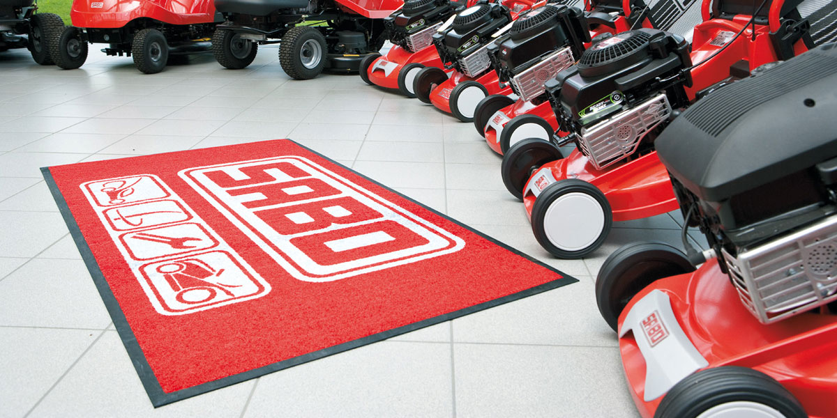 Jet-Print - custom mat with printed SABO logo (John Deer) promoting lawn mowers