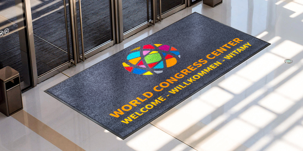 Jet-Print - grey Jet-Print mat with colourful elements in front of the door promoting the world congress center